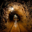 Underground mine passage with rails — Stock Photo #23338950