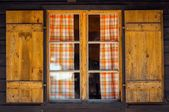Small wooden cottage with window — Stock Photo