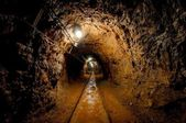 Underground mine passage with rails — Stok fotoğraf