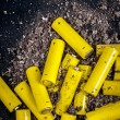 Artistic way to represent little yellow batteries — Stock Photo
