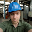 Young engineer in a power plant — Stock Photo #26442297