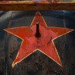 Stock Photo: Soviet symbol on metal background