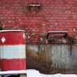 Red brick wall with barrel — Stock Photo