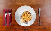Delicious french fries closeup — Stock Photo