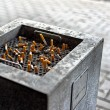 Cigarettes in a public ashtray — Stock Photo