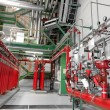 Stock Photo: Large CO2 fire extinguishers in power plant