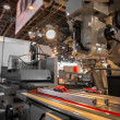 Industrial machines working for the weak humans — Stockfoto