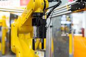 Robot arm in a factory — Stok fotoğraf