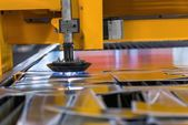 Machine cutting steel in a factory — Stock Photo