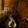 Used abandoned toilette in grungy room — Stock Photo