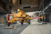 Yellow mobile industrial crane in a building — Stock Photo