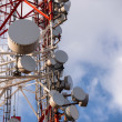 Large Communication tower against sky — Stock Photo #35347733