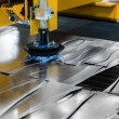 Machine cutting steel in factory — Stock Photo #35347917