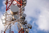Large Communication tower against sky — Stock Photo