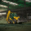 Industrial interior with bulldozer inside — Stock Photo