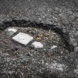 Tarmac road with big holes in Belgium — Stock Photo