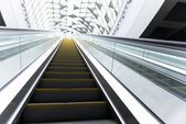 Moving escalator in the business center — Stock Photo
