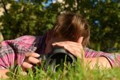 My beloved one taking photos on the ground — Stok fotoğraf