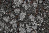 Tarmac road with big holes in Belgium — Stock Photo