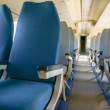 Interior of an airplane with many seats — Stock Photo