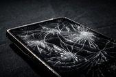 Smartphone with broken screen — Stock Photo