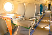 Interior of an airplane with many seats — Stockfoto