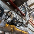Industrial pipes in a thermal power plant — Stock Photo #46518609