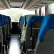 Interior of a bus with many seats — Stock Photo #8800334