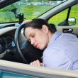 Royalty-Free Stock Photo: Young girl sleeps in her car.