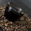 Coffee beans, cup, Pots, cinnamon on dark background — Stok fotoğraf