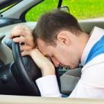 Man sleeps in a car — Stock Photo #17615617