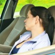 Young girl sleeps in her car. — Stock Photo #18125505