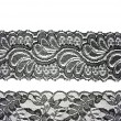 Stock Photo: Black lace with pattern in manner of flower on white backgro