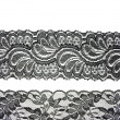 Black lace with pattern in the manner of flower on white backgro — 图库照片
