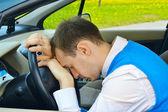Man sleeps in a car — Stock Photo