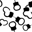 Seamless pattern of handcuffs silhouettes vector illustration on — Stock Vector