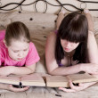 Girls reading book on bed — Stock Photo #22995776