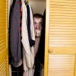 A man hiding in the closet — Stock Photo