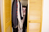 A man hiding in the closet — Stockfoto