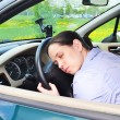 Young girl sleeps in her car. — Stock Photo #38815521