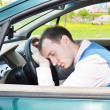 Stock Photo: Msleeps in car