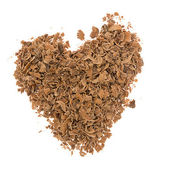Heart from grated chocolate — Stock Photo