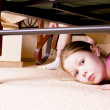 The child hides under a bed. — Stock Photo #39067105