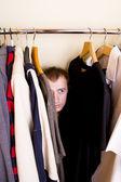 A man hiding in the closet — Stock Photo
