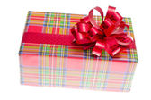 Big gift red box with ribbon isolated on a white background — Stock Photo