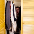 Stock Photo: A Man Hiding in the Closet