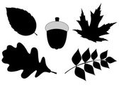 Acorn with Leaves Vector Silhouette Illustration — Stock Vector