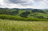 Meadows, green hills and clouds — Stock Photo