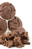 Chocolate muffins and crumbs — Stock Photo