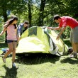 Family doing camping in the forest — Stock Photo #13936919